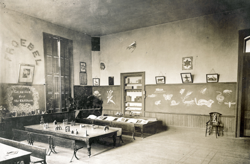 Sepia-toned photo of Susan Blow's classroom