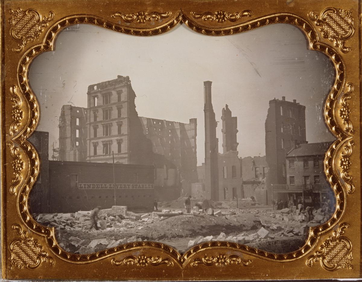 Black-and-white daguerreotype in case showing Lindell Hotel ruins