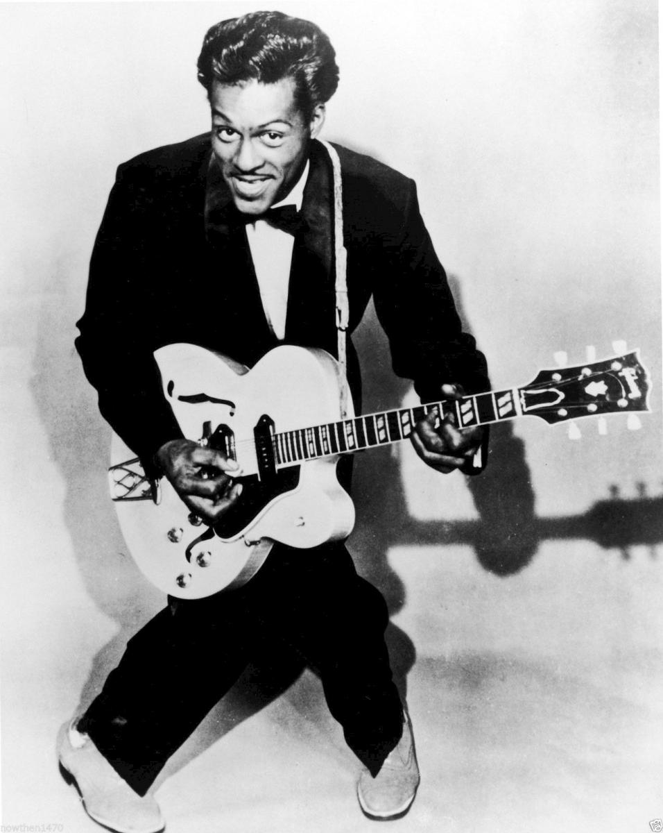 Black-and-white photo of Chuck Berry with legs in X shape