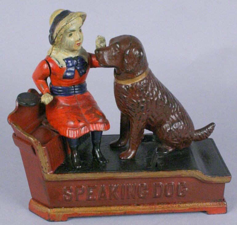 mechanical bank with a girl and her dog