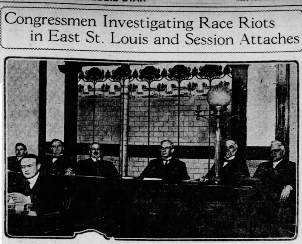 Black-and-white scan of newspaper photo showing the five congressional committee members