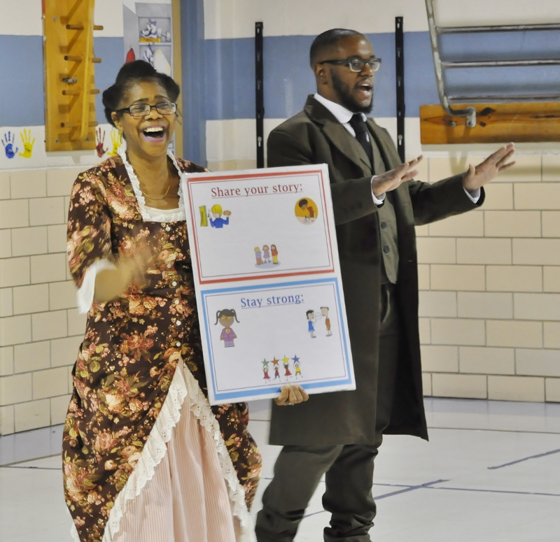 Color photo of two ACTivist actor-interpreters portraying historic figures during an in-school visit