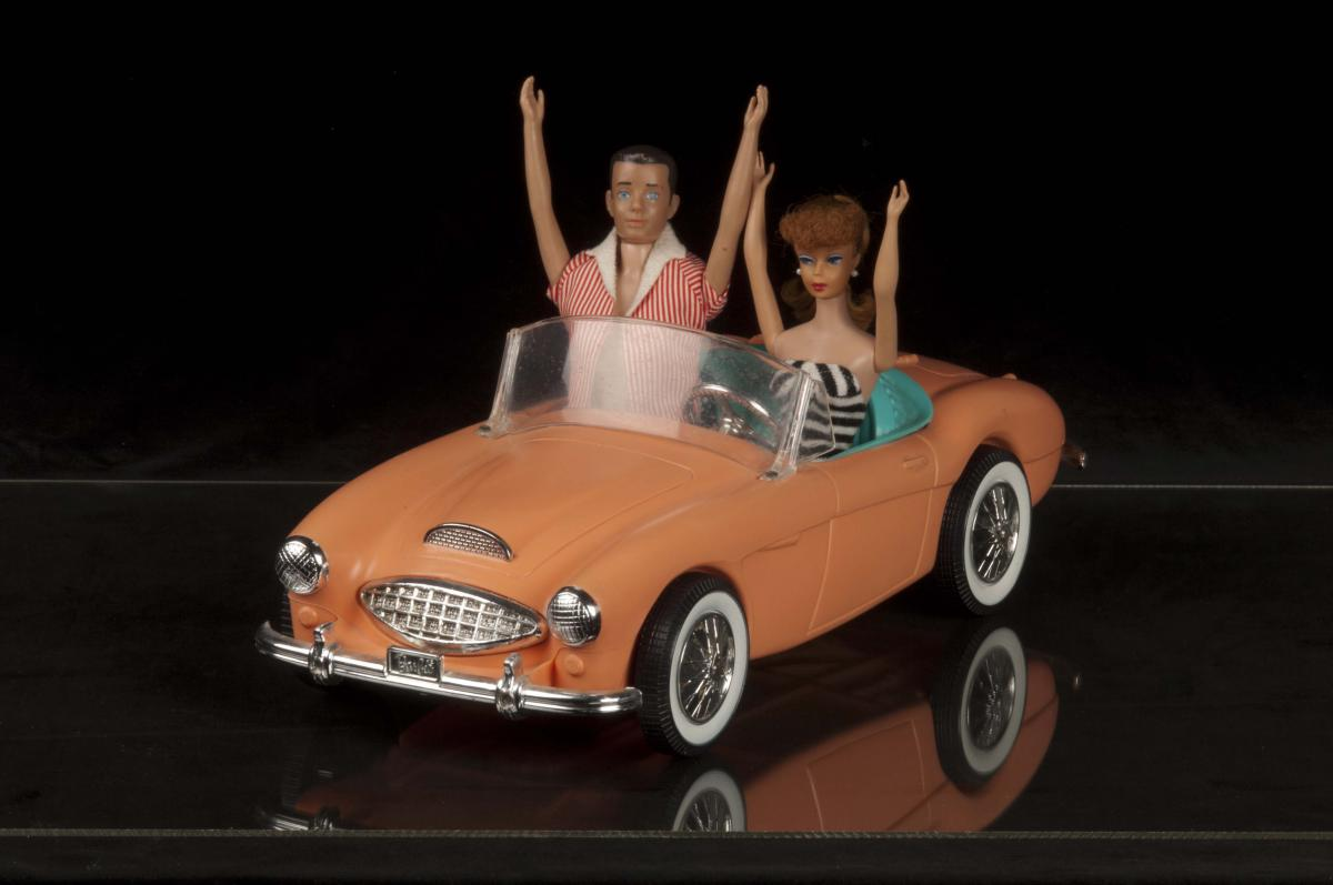 Color photo of Barbie and Ken in her Austin-Healy 3000