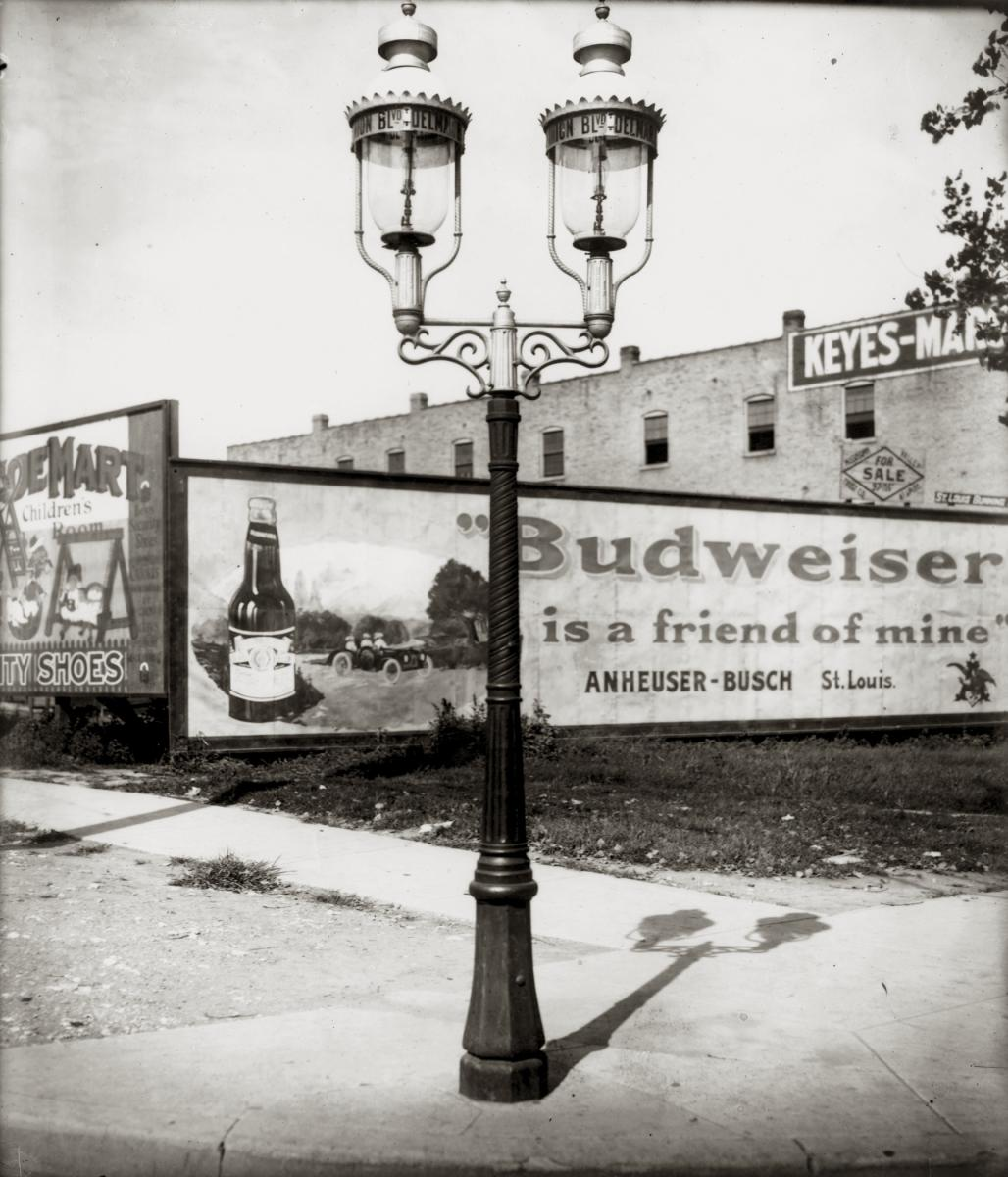 Black-and-white photo of Budweiser billboard