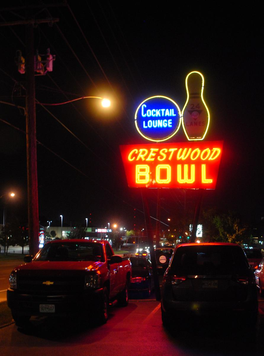 Color photo of the Crestwood Bowl sign at night