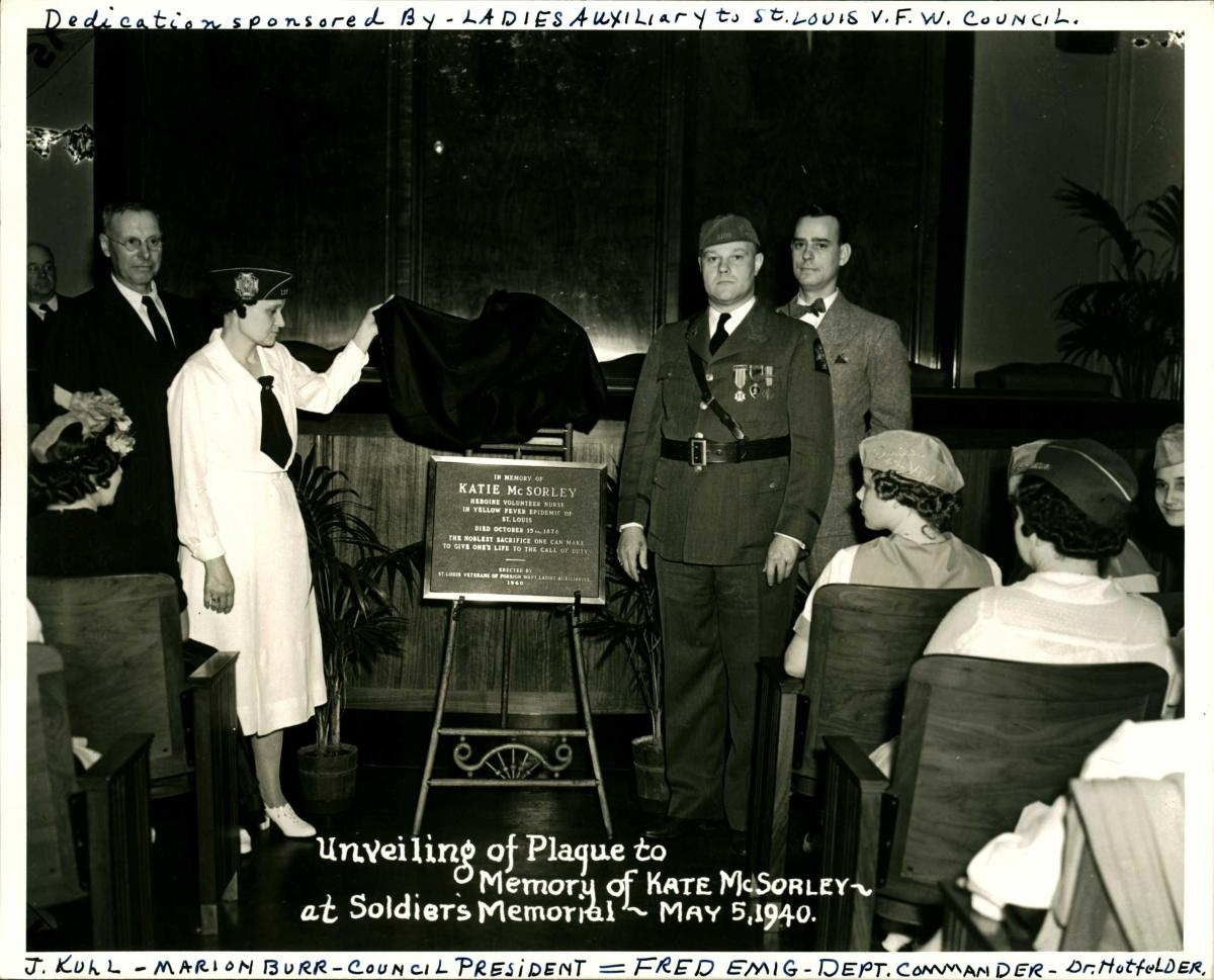 Black-and-white photo from ceremony dedicating plaque to Kate McSorley