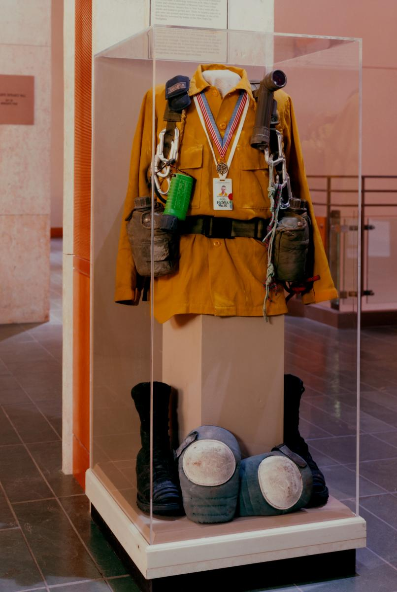 Color photo of display of Dennis Grooms's 9/11 rescue gear at MHM