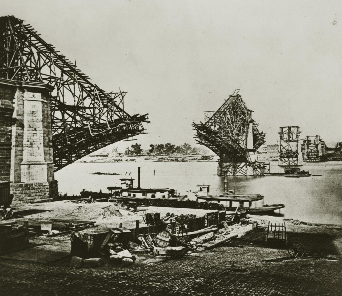 A black and white photograph of the Eads Bridge under construction in September 1873, looking northeast.