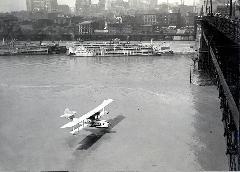 Bi-plane flying under Eads Bridge, ca 1930s