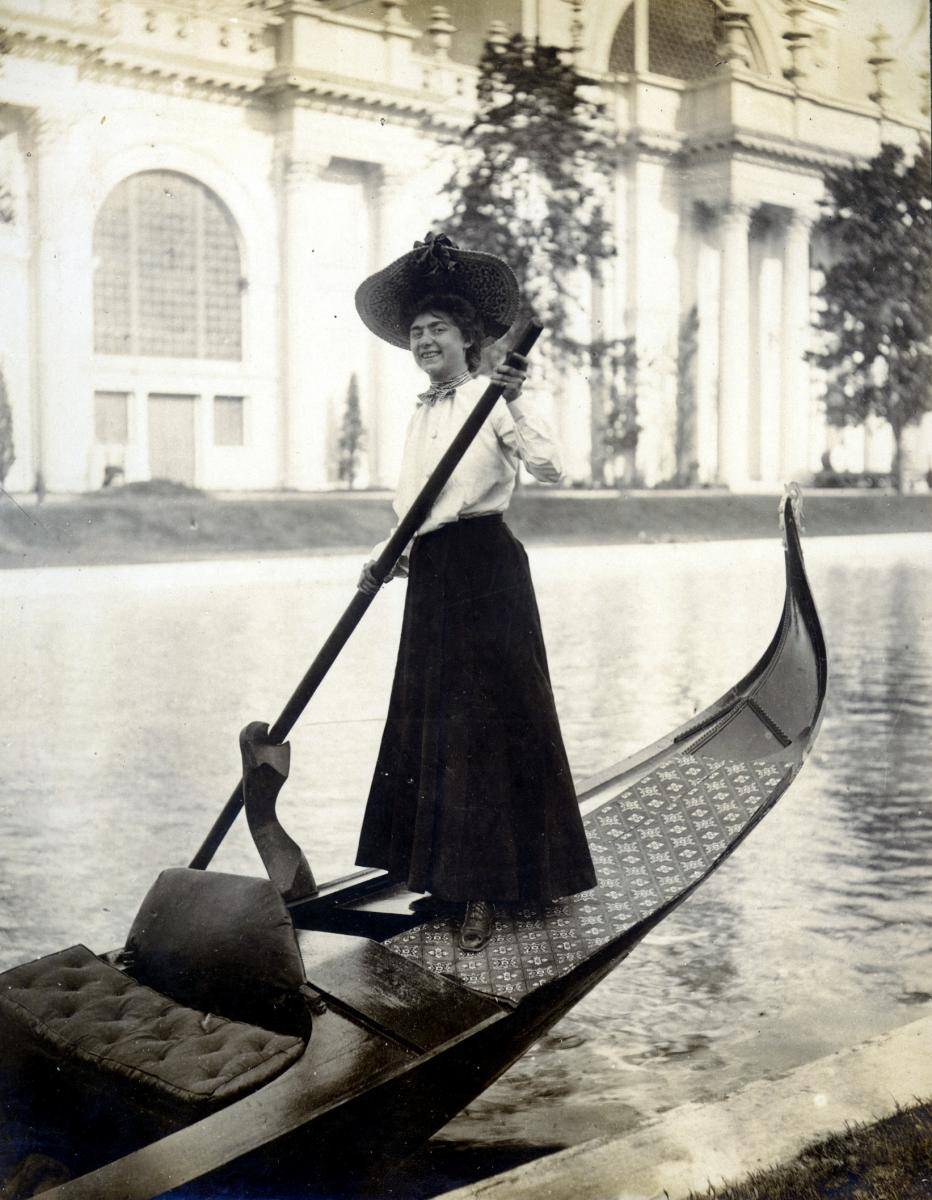Sepia-tone photo of a woman rowing a gondola at the 1904 World's Fair.