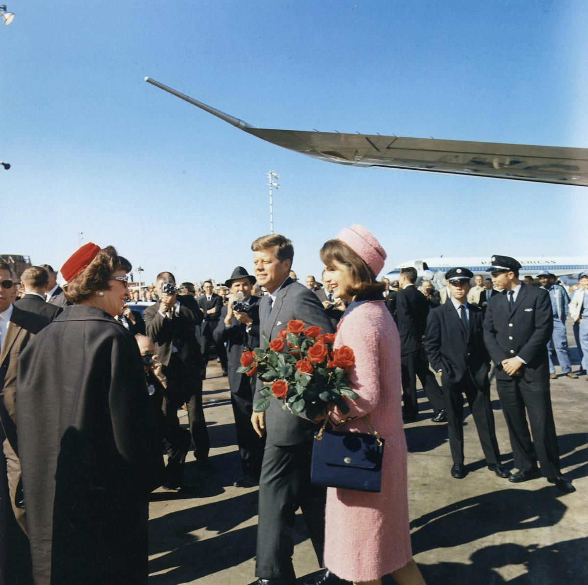 Color photo of President John F. Kennedy and First Lady Jackie Kennedy arriving in Dallas in November 1963