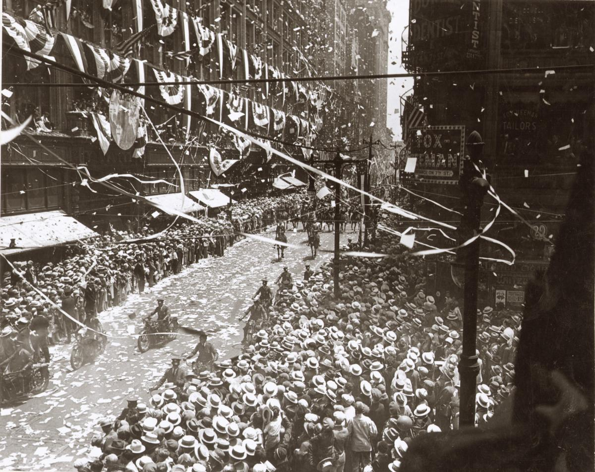 Sepia-toned photo of celebratory parade for Charles Lindbergh in St. Louis on June 18, 1927