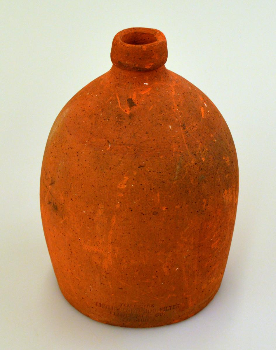 Color photo of brown water-purification jug