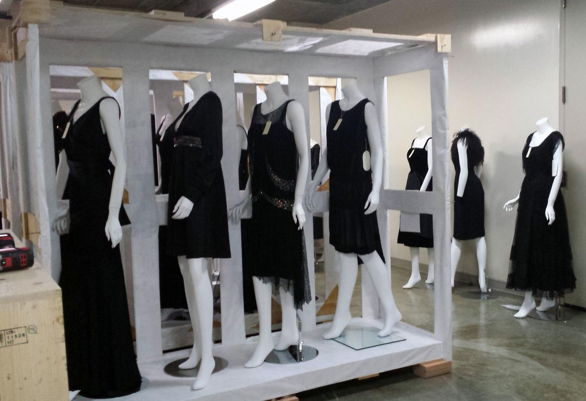 Image of black dresses being prepared for their move to the Missouri History Museum from the Library and Research Center