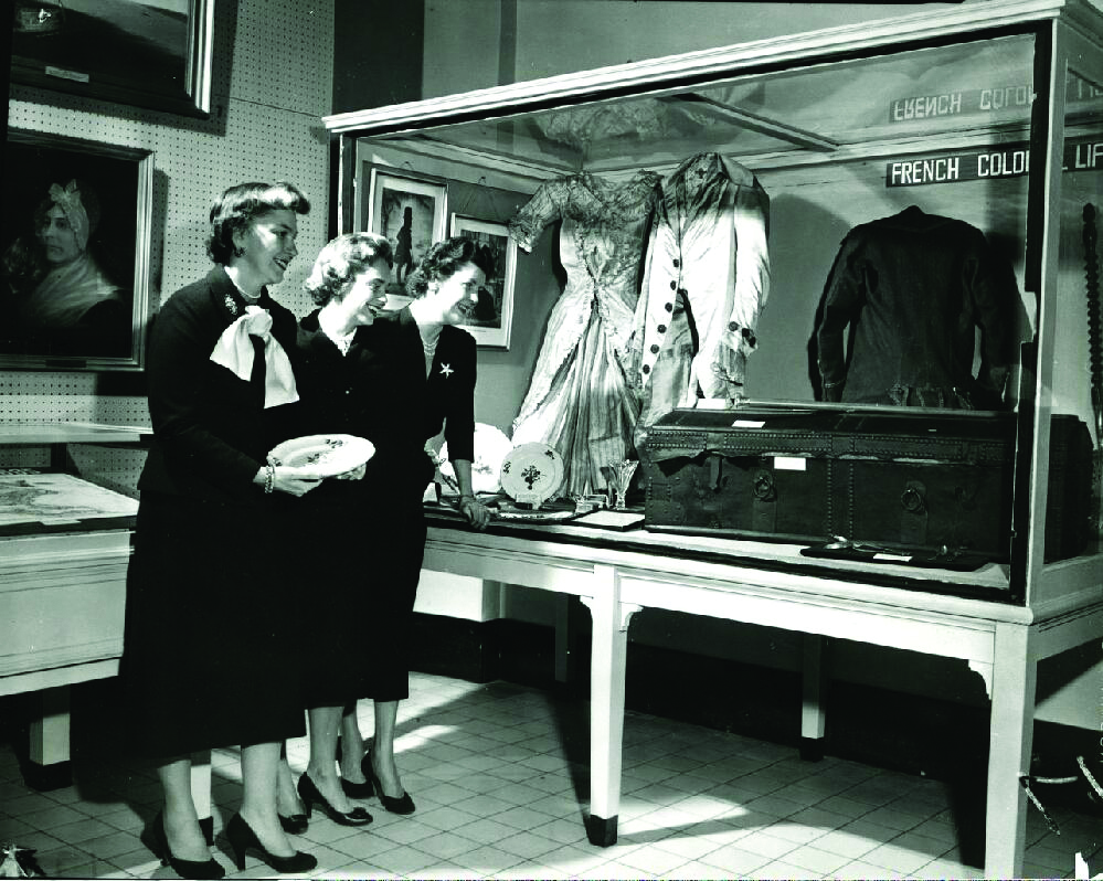 Black-and-white photos of visitors in the Costume Room
