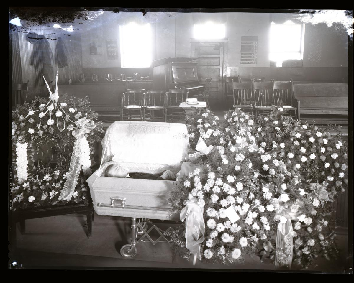 Photo of man in casket