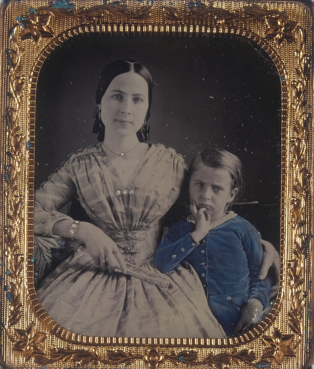 Scan of a daguerreotype of a mother and child