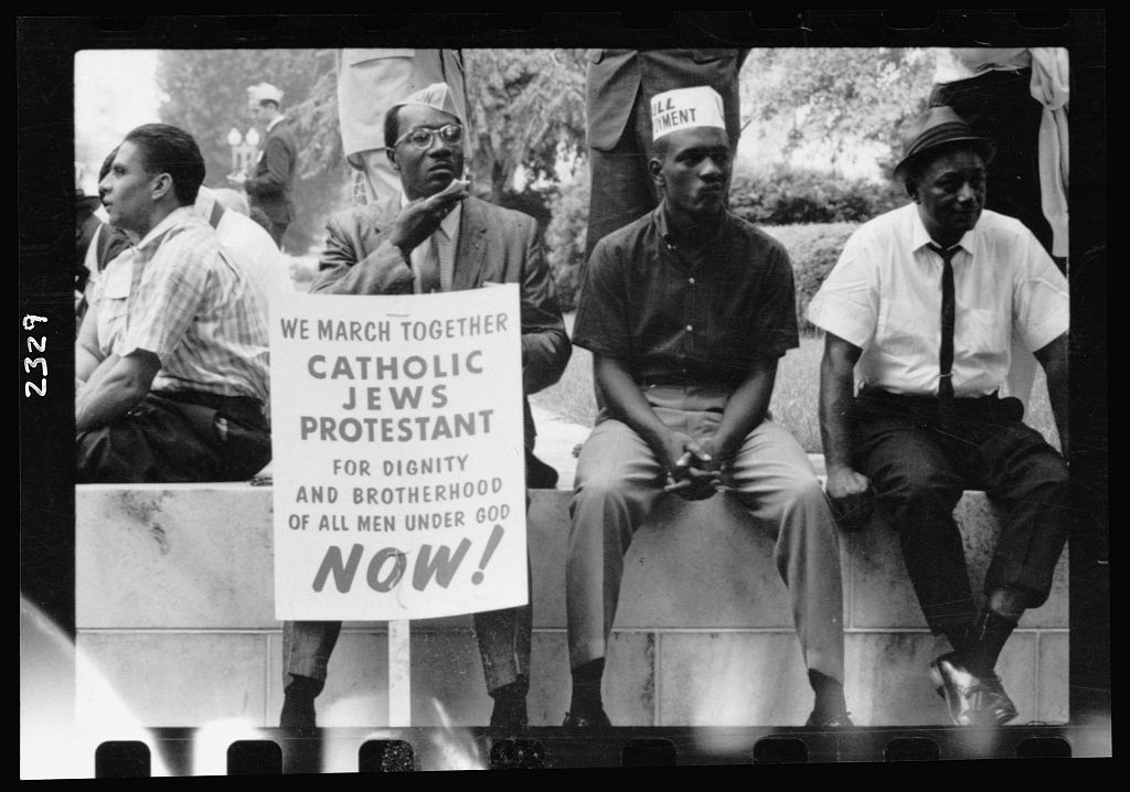 Black-and-white photo of Selma marchers resting