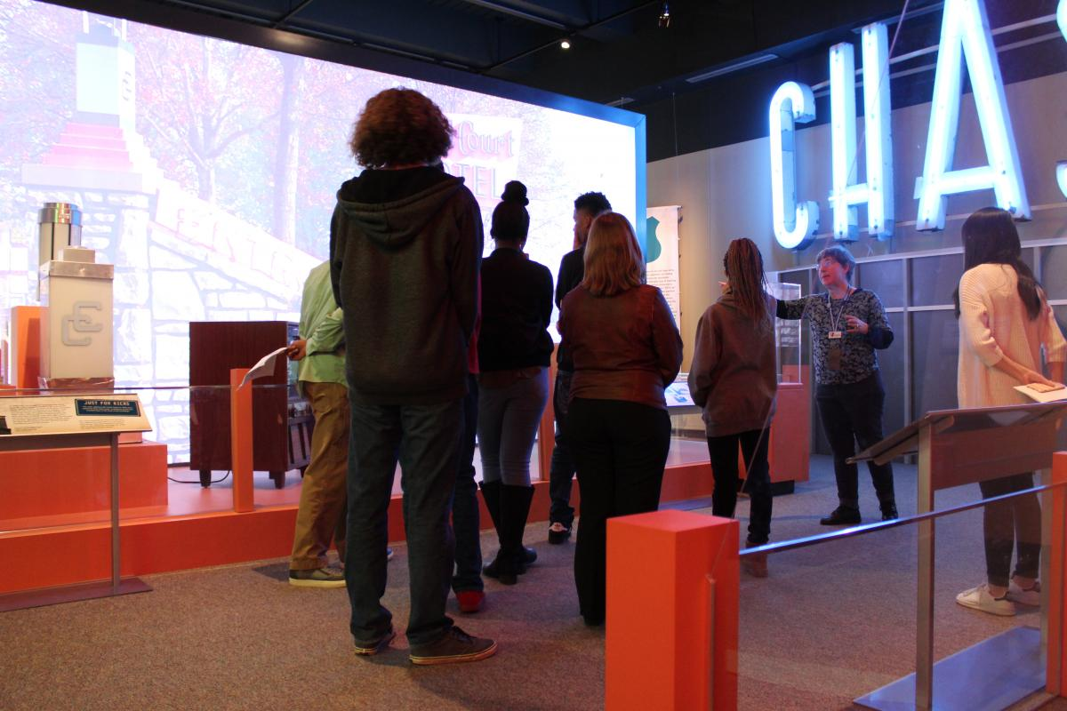 "Color photo of TMH Academy students getting private tour of our ""Route 66"" exhibit"