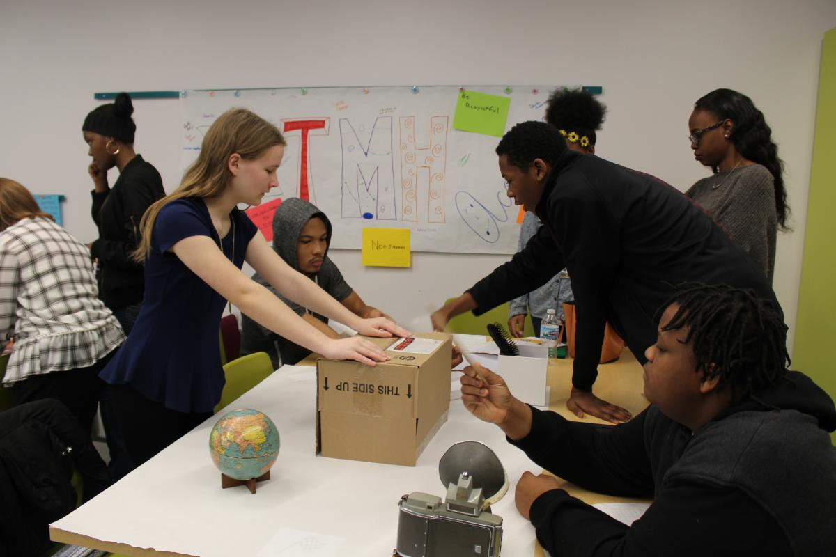 Color photo of TMH Academy students participating in a museum challenge