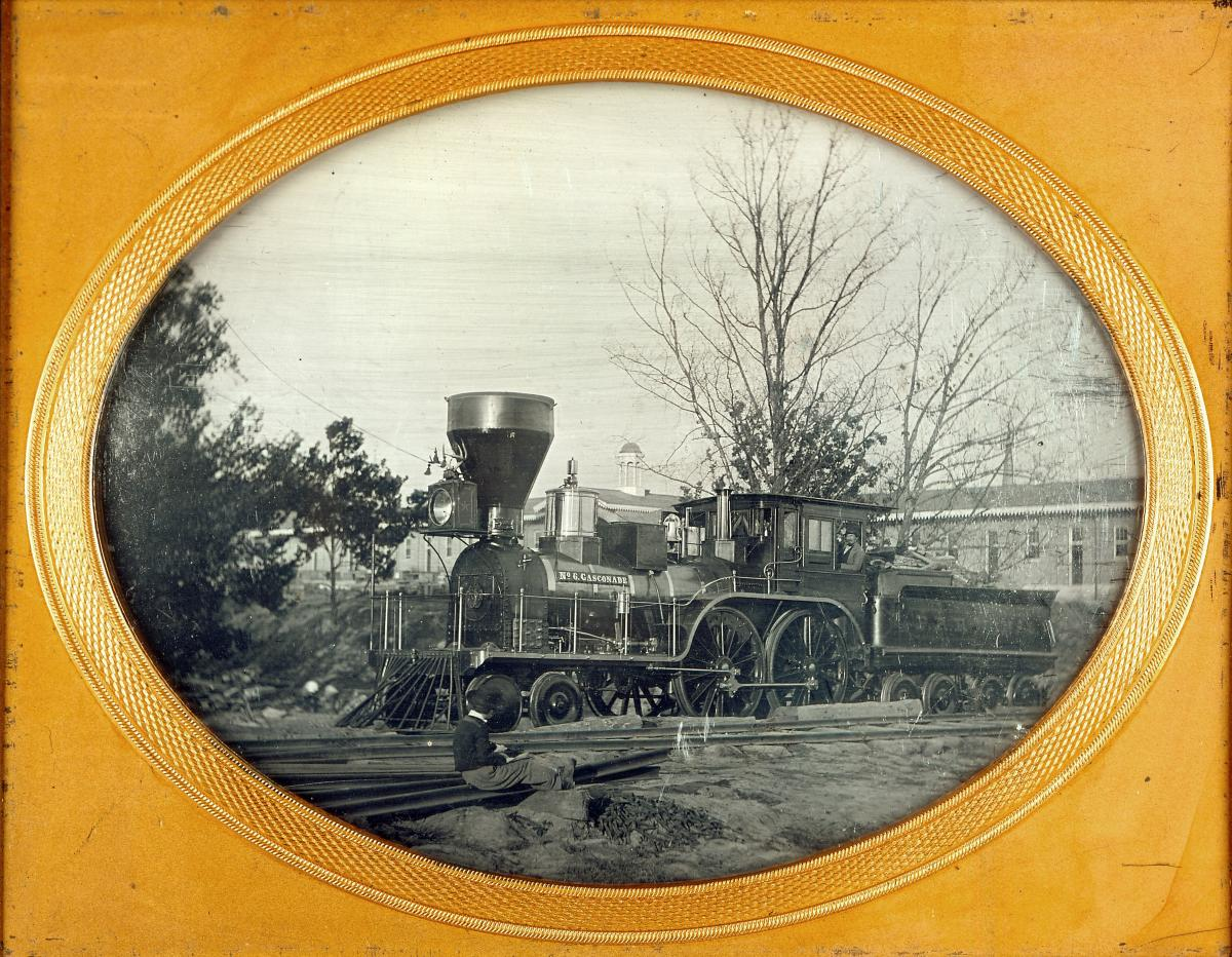 Black-and-white daguerreotype showing Pacific Railroad locomotive number 6 in a gold frame