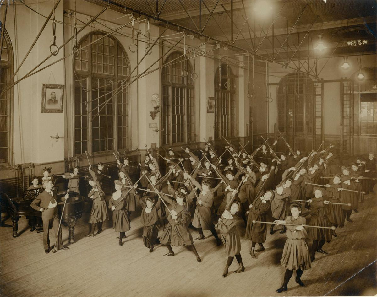 Sepia-toned photograph of a ladies' bar drill class at the South St. Louis Turnverein, ca. 1910
