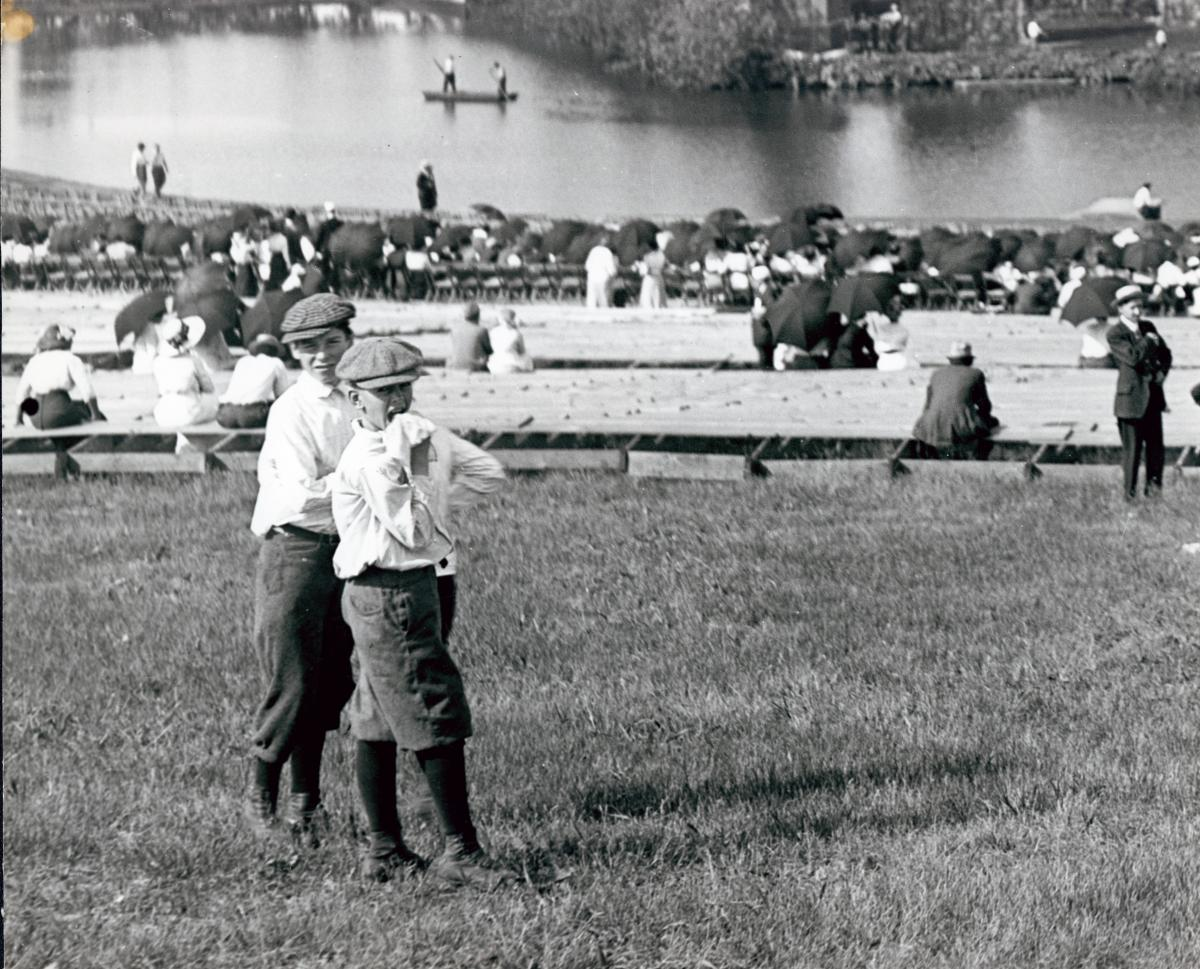Black and white photo of two boys in front of a lake.