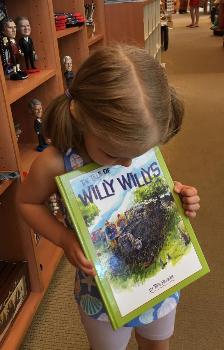 Photo of child holding book
