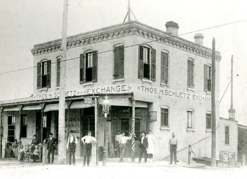 Men standing in front of a saloon in St. Louis in 1897